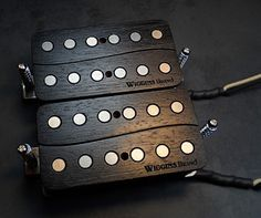 Wiggins Brand All Wood Guitar Pickups in ebonized walnut. This is a custom requested shape and sound spec to Arizona luthier Doug Shelton www.wigginsbrand.com