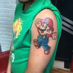 Mario tattoo done by @finleyartworks.  #tattoos #ink #videogametattoo #gamertattoo #gamerink #videogames #gamer #gaming #nintendo #nes #snes #supernintendo #n64  gamecube #wii #wiiu #gameboy #mario #supermariobros #mariobros #mariotattoo