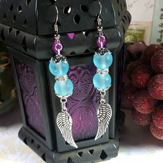 Only $6.79! - Stunning Stacked Blue Frosted Glass Beads, Silver Angel Wing Charm Earrings with Silver Round Rhinestone Disks & Flower Bead Caps - FREE USA SHIPPING https://www.etsy.com/listing/454514800/stacked-blue-frosted-glass-beads-silver