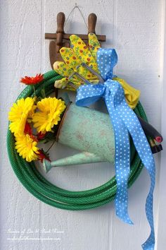 diy garden hose wreaths from our fairfield home garden, crafts, gardening, how to, repurposing upcycling, wreaths, Garden Hose Wreath with Watering Can
