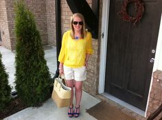 old navy yellow blouse  j. lo (kohl's) sparkle shorts  mar y sol straw tote  forever 21 gold bangles  keti sorely acrylic monogram necklace  dee keller blue suede heel    www.acupoflindsayjo.com