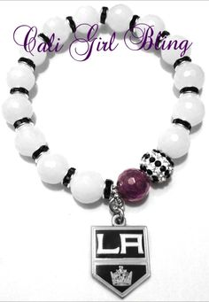GORGEOUS L.A KINGS Semi Precious Stone Beaded Bracelet! This handmade ORIGINAL design features 10mm Faceted Opaque White Agate Beads, Black Pave Rhinestone Spacers, 10mm Black  White Pave Rhinestone Bead, Purple Amethyst Bead,  Licensed L.A KINGS Logo Charm, $48.00  www.caligirlbling.storenvy.com    SI...