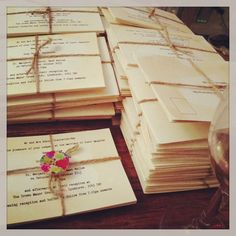 Wedding invitations, tied with twine and a wooden button