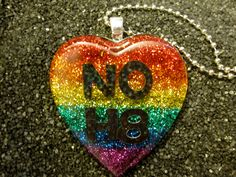 Rainbow NOH8 gay rights necklace by CardCarryingLesbian on Etsy, $20.00