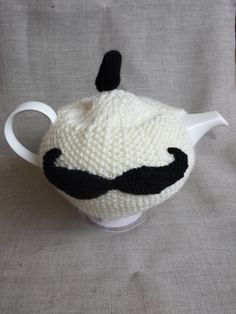 Check out this item in my Etsy shop https://www.etsy.com/listing/208484362/hand-knitted-moustache-tea-cosy