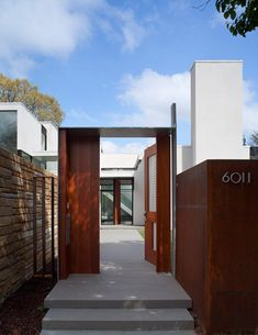Jigsaw Residence by David Jameson Architect.  Love the entryway juxtaposition of the straight lines of white walls and the warmth of the dark wood.