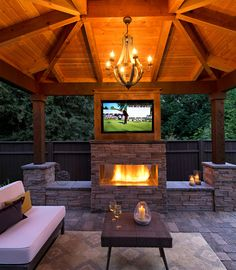 Rustic-Modern fireplace with seat walls http://www.paradiserestored.com/landscaping-blog/enjoying-life-relaxing-little-golf-side/