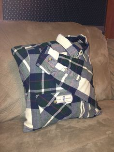 A flannel shirt pillow, made by my mom, to memorialize one of my grandfathers old shirts.