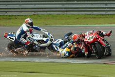 Haga (41) holds a brief lead over Toseland (52) Corser (1) and Bayliss.