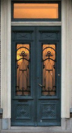 Art Nouveau double doors made of wood, glass and ironwork. Teal Front Doors, Teal Door, Iron Front Door, Double Front Doors, Front Door Colors, Cool Doors, The Doors, Unique Doors, Windows And Doors