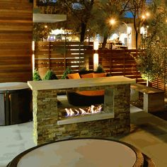 As well as the wood fire pit in the backyard, I'd like something gas (propane) fueled with an easy on/off switch. For when I want warmth in the evenings, without the wood fire hassle. Outdoor See Thru Gas Fireplace Modern Pergola, Outdoor Pergola, Pergola Kits, Outdoor Spaces, Outdoor Decor, Pergola Ideas, Backyard Pergola, Pergola Plans, Patio Ideas