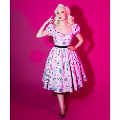 Flash Vixen Swing Dress in Vintage Hair and Makeup Print Vixen by... (130 CAD) ❤ liked on Polyvore featuring dresses, light purple, women's clothing, back zipper dress, vintage pink dress, stretch dresses, trapeze dress and puff sleeve dress