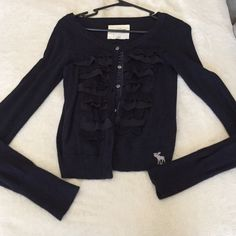 Abercrombie & Fitch navy blue cardigan XS Abercrombie & Fitch button up navy blue cardigan. Ruffles on front. Size XL in kids, would fit an extra small in women's. Perfect condition, no flaws. Abercrombie & Fitch Sweaters Cardigans