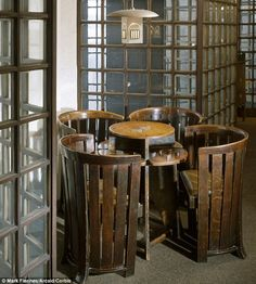 Stylish: A Domino table and chairs by Charles Rennie Mackintosh...