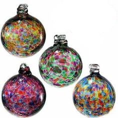"""Kitras Art Glass Blown Glass Friendship Ball Ornament Set/4. This lovely set of 2"""" Calico blown glass Friendship Ball ornaments are from Kitras Art Glass. This assortment features a lovely array of different color combinations, these lovely balls make wonderful ornaments, hostess gifts and just a great keepsake for those who appreciate the ancient art of glass-blowing."""