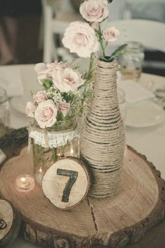 DIY Rustic Wedding Centerpieces / http://www.deerpearlflowers.com/wine-bottle-vineyard-wedding-decor-ideas/