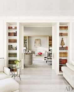 white upholstered chairs & bookcases