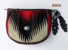 Medium Saddle Bag made of fine leather and fragment of vintage Navajo rugs.  Produced in the U.S.A. Find more designer handbags at www.pccohandbags.com
