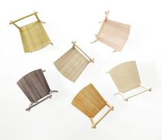 Rather than varnish these wooden chairs to colour and protect them, Japanese designers Nendo chose to wrap them in hundreds of metres of fishing line. Product photos are by Hiroshi Iwasaki.