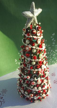 Button Covered Christmas Tree....combination of three deep red, green and white buttons....awesome!