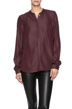 The Day Shirt is a long-sleeved flowy button-up blouse that features a high slit in the back and a hi-lo hemline.   Day Shirt by Vero Moda. Clothing - Tops - Button Down Clothing - Tops - Long Sleeve Louisiana