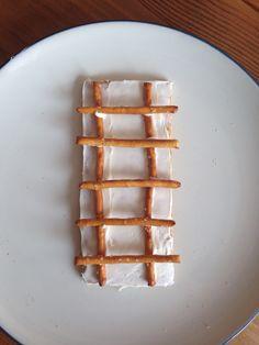 Jacob's Ladder Snack (graham cracker, frosting and pretzels) - Homeschool Kindergarten Activity - Sonlight Core A Bible Week 3 Jacob