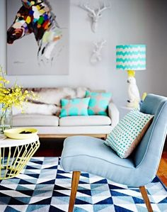 This is my dream Lounge room, from the Mozi Cockatoo Lamp, Deer Heads and the Horse Canvas, everything just works, it's chic, and a bit kitsch. Just the right amount of colour, pattern and texture. ~Sarah Cockatoo lamp. I want one!