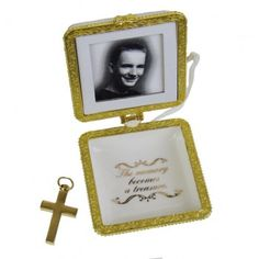 Remember your loved one this with our When Someone Keepsake Urn. This ornament is made of porcelain with gold brass trim on a white satin ribbon. The cross is a and can hold ashes or lock of hair. The top of the ornament holds an image of your loved one. Keepsake Urns, Losing A Loved One, Hair Locks, Sympathy Gifts, When Someone, Ornaments, White Satin, Grief, Frame