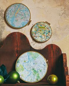 Embroidery hoop maps- spray paint the hoops silver then add maps to hang in Mission's Room.