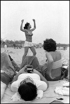 In Little Italy, on the train to Rockaway, and at Rockaway Beach. Photographs by Susan Meiselas, 1978.
