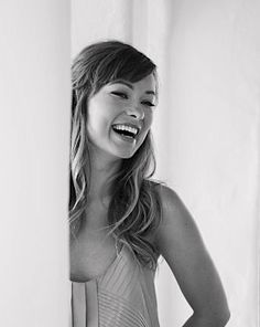 Olivia Wilde. Because I don't want to die without having seen this smile.