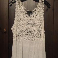 White Gauzy Lace Top. Perfect for summer! Very cute white gauze top with lace at the top both front and back. Only worn 2-3x Max. Cute over bathing suit or with white cami & jeans. No rips or stains. Good condition. Fits true to large size. Tag says PL - petite but I think it fits like a regular large. Ralph Lauren Tops
