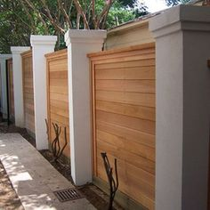 Privacy fence with columns and horizontal wood planks