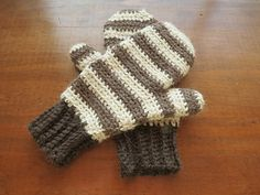 These Striped Fitted Mittens work up fast and easy with a bulky sized yarn and the use of a size G hook for tighter stitching. You can wear them as they are or even line them with polar fleece for colder climates.