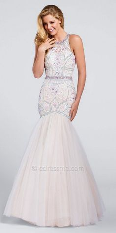 Have an unforgettable night in the stunning Tulle Embroidered Halter Mermaid Prom Gown by Ellie Wilde for Mon Cheri. This style features a halter neckline, a keyhole back with an invisible zipper and a sleeveless bodice. The figure flattering mermaid silhouette includes beautiful embroidery, beading at the neck and waistline and a tulle at the bottom for a dramatic flared effect.  #edressme