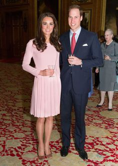 Kate Middleton in a baby pink Emilia Wickstead dress, with Prince William. May, 2012.