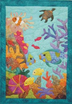 Reef Life is an appliqued and quilted pattern producing a world of underwater life, by Tracey Campbell of www.topoftherangedesigns.com and Artfiberstitch.