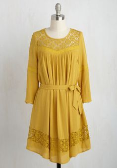 If it's smiles you seek and positivity you pursue, this marigold yellow dress will have them following you! This frock's illusion neckline - crocheted to match a diamond-patterned skirt panel - puts you in high spirits, while its vented, 3/4-length sleeves, gathering, and sash are responsible for onlookers' optimism.