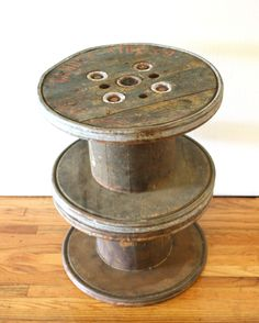 Industrial Spool Side Table from Camden Wire Co. - This is an antique industrial spool table from the Camden Wire Co. in New York.  This side table is made of 2 mini wooden spools used to hold wire.  Each spool has a great patina, distinctive marks and rimmed with metal.  There is an optional glass top that comes with it.  Dimensions: 16″ diameter x 21″H  AVAILABLE