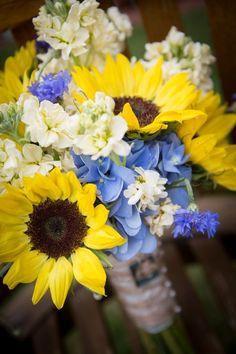 Lovely Wedding Bouquet Arranged With: White Stock, Yellow Sunflowers, Blue Hydrangea + Blue Cornflower