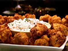 Food Network invites you to try this Shrimp Hushpuppies with Vidalia Onion Dip recipe from Patrick and Gina Neely.