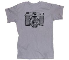 I LOVE camera shirts.  @Derek Smith the Shot, maybe something like this...but with colors and the logo?