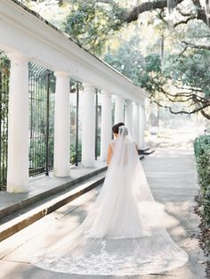 Long train embellished wedding veil: http://www.stylemepretty.com/georgia-weddings/savannah/2016/09/12/a-traditional-southern-cathedral-wedding-bathed-in-blue/ Photography: The Happy Bloom - http://www.thehappybloom.com/