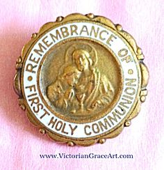 $29 Very old 3/4 inch diameter First Holy Communion remembrance pin.  Goldtone and white enamel. C-clasp closure.