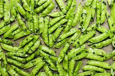 Roasted Sugar Snap Peas with Mint + Sea Salt | Vegan, gluten-free, roasted sugar snap peas with mint, salt, black pepper and a hint of lemon completely transform in the oven. Spring peas at their best.