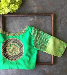 Stunning crayon green color designer blouse with hand embroidery kundan work on sleeves. Blouse with elephant motif and net design on back of blouse. You are my green crayon the one I never have enough of the one I use to colour my garden. Blouse Back Neck Designs, Simple Blouse Designs, Stylish Blouse Design, Silk Saree Blouse Designs, Silk Sarees, Dress Designs, Blouse For Lehenga, Blouse Designs Wedding, Pattern Blouses For Sarees