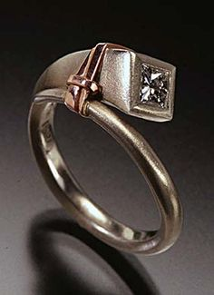 Andy Cooperman Jewelry  Band around the ring, setting on the end, transition from round to square.