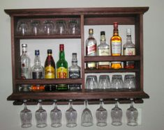 These Mini Bars are perfect for storing your barware in a small space, great for apartments, living rooms, or down in the man cave. Where else could you store 8 wine glasses, 9 highball glasses, over 12 shot glasses and 6 bottles of your favorite spirits all in a 3 foot by 2 foot wall space. It can hold the bigger 1/2 gallon bottles also.  I make these Mini Bars with great pride. I start by picking the best pine with good looking grains, I then sand these Mini Bars three times to make the…
