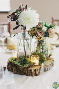 Tree slices as a base for the centerpieces at a garden, rustic or enchanted forest wedding