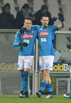 Marek Hamsik and Piotr Zielinski of SSC Napoli celebrate the 0-2 goal scored by Piotr Zielinski during the Serie A match between Torino FC and SSC Napoli at Stadio Olimpico di Torino on December 16, 2017 in Turin, Italy. - 47 of 105